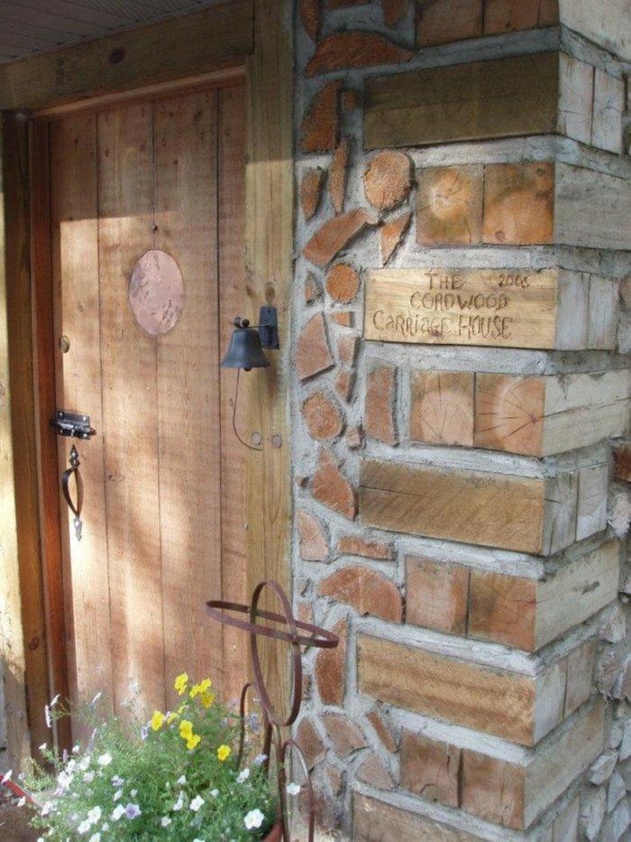 namas is malku fasadas durys